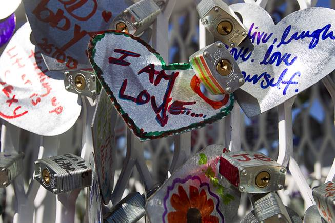 An art installation is shown during the Life is Beautiful Festival in downtown Las Vegas Sunday, Oct. 27, 2012. People create messages on heart-shaped, aluminum pieces that are padlocked onto the sculpture.