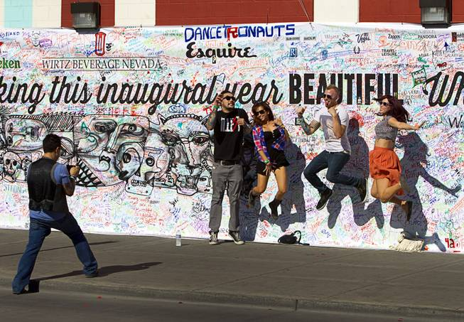 A group poses for a photo during the Life is Beautiful Festival in downtown Las Vegas Sunday, Oct. 27, 2012.