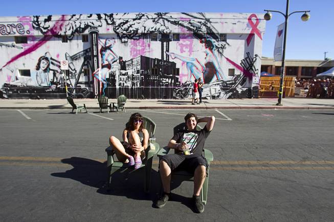 Sarah April and Jared Kash of Las Vegas hang out on 7th Street during the Life is Beautiful Festival in downtown Las Vegas Sunday, Oct. 27, 2012.