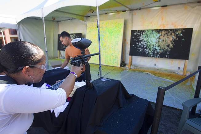 Gayland (no last name given) uses a paintball gun to make art during the Life is Beautiful Festival in downtown Las Vegas Sunday, Oct. 27, 2012.