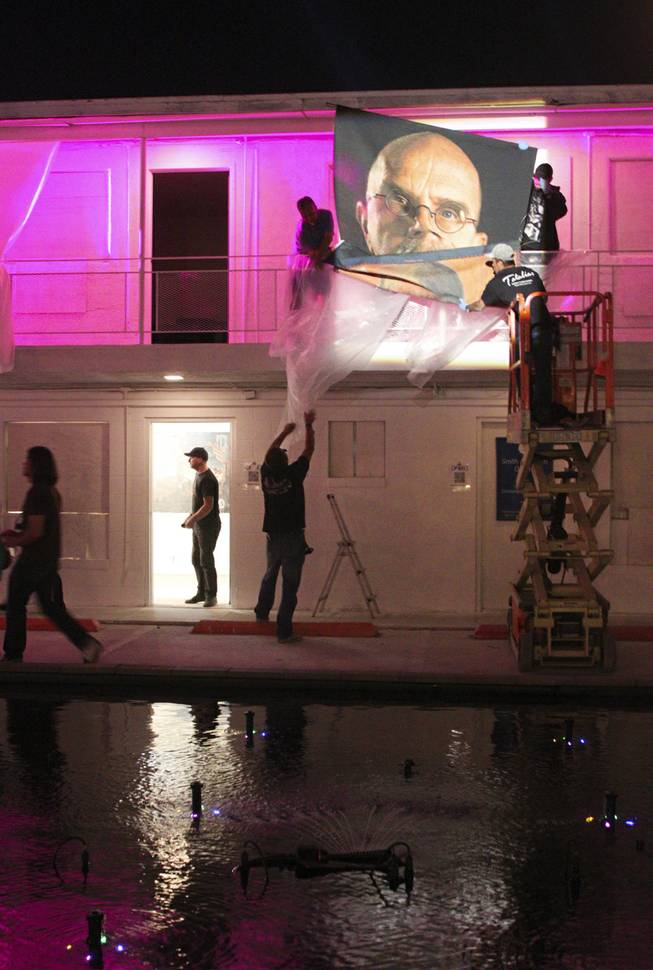 The Chuck Close tapestry at the 'Art Odyssey' is taken down on the closing of the Life Is Beautiful Festival, Sunday, Oct. 27, 2013.