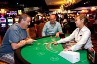 Steve Shannon, left, and Frank Smolinski, visiting from Ohio, play a hand of blackjack during the opening of the Downtown Grand Las Vegas Hotel and Casino in Las Vegas Sunday, October 27, 2013.