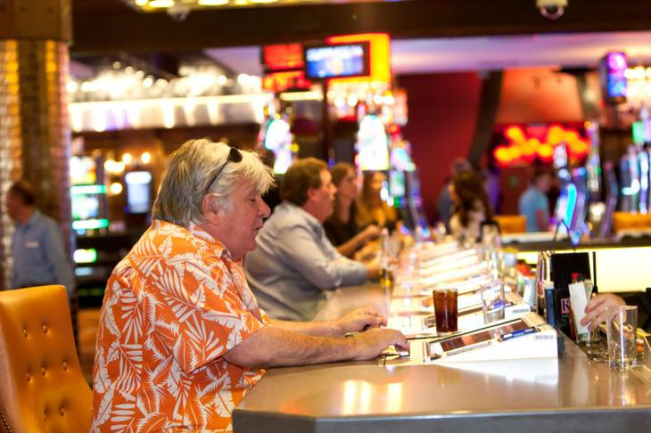 Kid Cary, of Las Vegas, plays video poker during the opening of the Downtown Grand Las Vegas Hotel and Casino in Las Vegas Sunday, October 27, 2013.