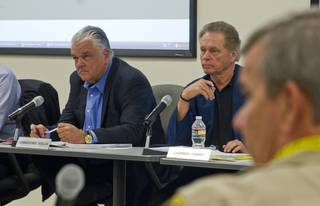 (From left) Commissioners Steve Sisolak and James Hammer with Sheriff Doug Gillespie listen to the details of a lawsuit settlement during a fiscal affairs committee meeting at the Metro Police headquarters Monday, Oct. 28, 2013. L.E. Baskow