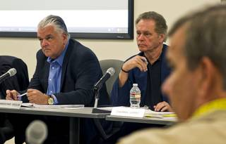 (From left) Commissioners Steve Sisolak and James Hammer with Sheriff Doug Gillespie listen to the details of a lawsuit settlement during a fiscal affairs committee meeting at the Metro Police headquarters Monday, Oct. 28, 2013.