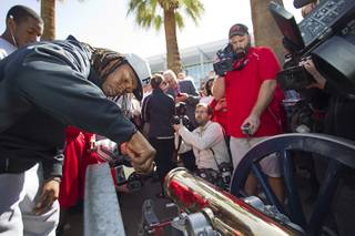 UNLV football players paint the Fremont cannon during a ceremony on UNLV campus Monday, Oct. 28, 2013. The UNLV football team beat Reno Saturday 27-22 to break an eight-year losing streak in the rivalry game and gain possession of the Fremont cannon.