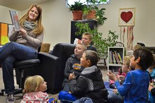 Michael-Ann Lazzarino shows children a book in the children's book nook in Virginia City in 2013. Lazzarino is the elementary programs director of Community Chest, a nonprofit group that opened the book nook last year  in its community center.  The Storey County Public Library closed in 2012.