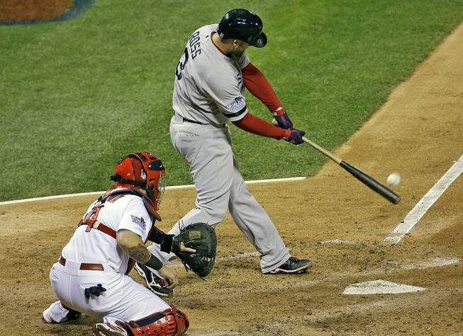 Boston Red Sox's David Ross hits an RBI double during the seventh inning of Game 5 of baseball's World Series against the St. Louis Cardinals Monday, Oct. 28, 2013, in St. Louis.