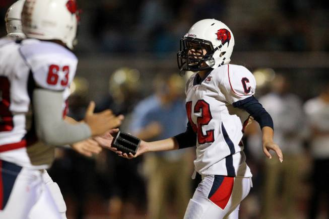 Coronado kicker Aliza Madden retrieves her kicking block after a PAT attempt during their game against Foothill Friday, Oct. 18, 2013.