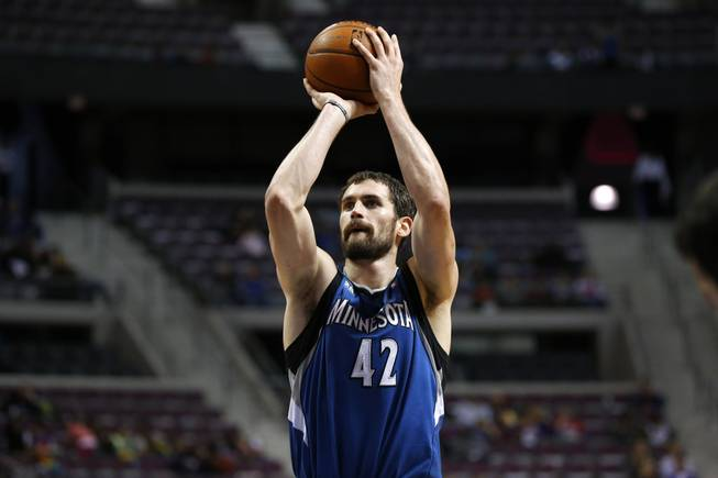 Minnesota Timberwolves forward Kevin Love shoots against the Detroit Pistons in the first half of their preseason NBA game in Auburn Hills, Mich., Thursday, Oct. 24, 2013.