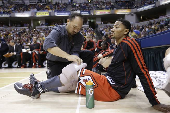 Chicago Bulls guard Derrick Rose gets his knees iced on the bench in the second half of an NBA preseason basketball game against the Indiana Pacers in Indianapolis, Saturday, Oct. 5, 2013. The Bulls defeated the Pacers 82-76.