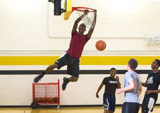 Jordan Turner dunks during intramurals at Clark High School Wednesday, Oct. 30, 2013.