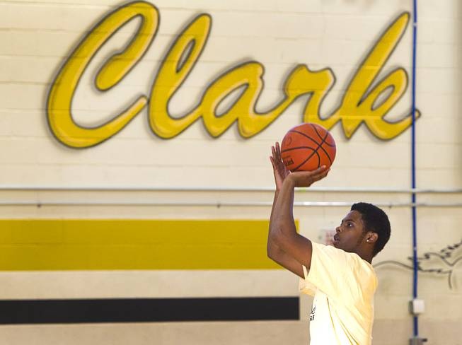 Diontae Jones takes practice shots during intramurals at Clark High School Wednesday, Oct. 30, 2013.