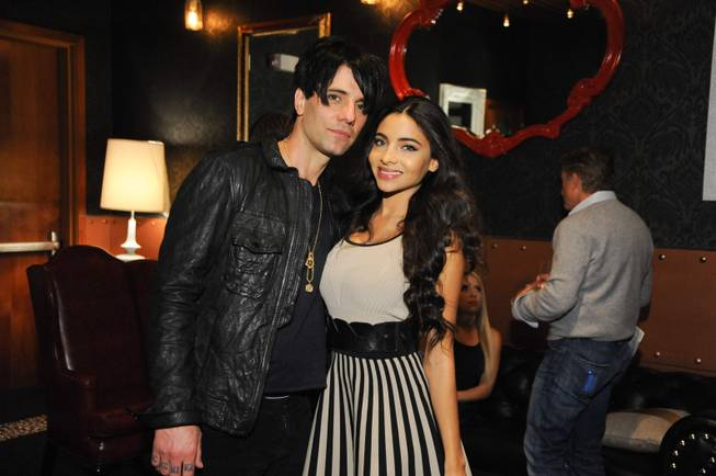 "Criss Angel, with fiancee Sandra Gonzalez, celebrates the fifth anniversary of his Cirque du Soleil show ""Believe"" at the Luxor on Wednesday, Oct. 30, 2013, at a party at Rx Boiler Room in Mandalay Place."