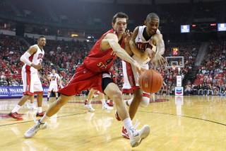 UNLV forward Christian Wood and Dixie State center Zach Robbins chase a ball during the Rebels exhibition game Friday, Nov. 1, 2013 at the Thomas & Mack Center.