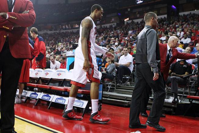 UNLV guard Bryce Dejean-Jones holds his hamstring as he heads to the locker room during the Rebels exhibition game against Dixie State Friday, Nov. 1, 2013 at the Thomas & Mack Center.