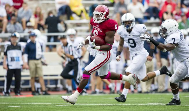 Indiana's Tevin Coleman (6) breaks through the Penn State defense and rushes the ball into the end zone for a touchdown during the second half of an NCAA college football game, Saturday, Oct. 5, 2013, in Bloomington, Ind. Indiana defeated Penn State 44-24.