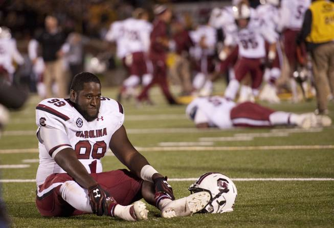South Carolina's Kelcy Quarles smiles as he sits on the field after defeating Missouri 27-24 in overtime of an NCAA college football game Saturday, Oct. 26, 2013, in Columbia, Mo.