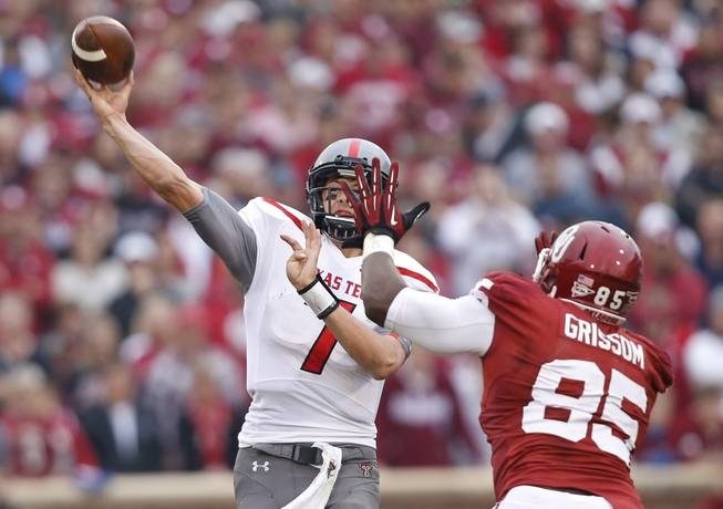 Texas Tech quarterback Davis Webb (7) passes under pressure from Oklahoma defensive end Geneo Grissom (85) in the first quarter of an NCAA college football game in Norman, Okla., Saturday, Oct. 26, 2013. Oklahoma won 38-30.