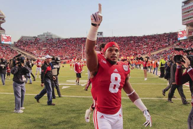 Nebraska running back Ameer Abdullah (8) gestures to fans in the stands following an NCAA college football game against Northwestern in Lincoln, Neb., Saturday, Nov. 2, 2013. Nebraska won 27-24.