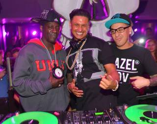 DJ Pauly D, center, with Flavor Flav and Kozmoe Alonzo, spins at Haze in Aria on Saturday, Nov. 2, 2013.