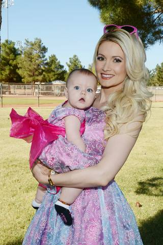 Holly Madison and daughter Rainbow Aurora Rotella attend the Animal Foundation's Forever Home Family Picnic on Sunday, Nov. 3, 2013, at Sunset Park in Las Vegas.