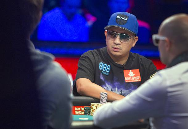 J.C. Tran, 36, a poker professional from Sacramento, Calif., competes during the final table of the World Series of Poker $10,000 buy-in no-limit Texas Hold 'Em tournament at the Rio Monday, Nov. 4, 2013. The 2013