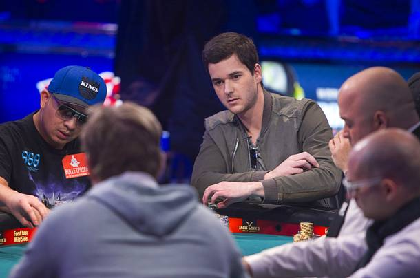David Benefield, right, 27, a part-time student and part-time poker professional from New York City,  competes during the final table of the World Series of Poker $10,000 buy-in no-limit Texas Hold 'Em tournament at the Rio Monday, Nov. 4, 2013. The 2013