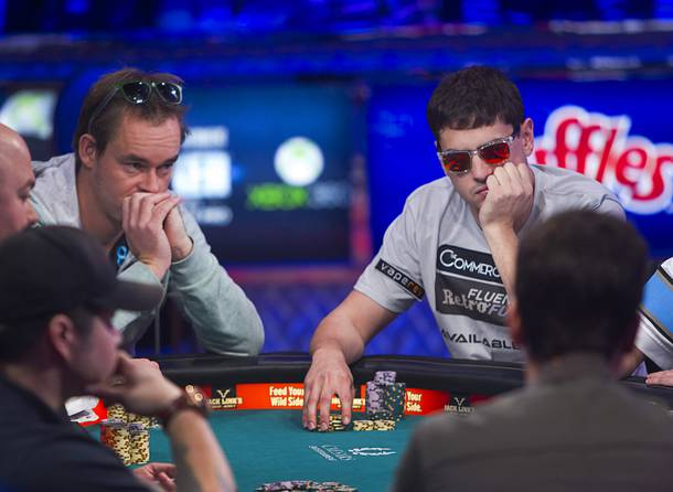 Mark Newhouse, right, 28, a poker professional from Los Angeles, competes during the final table of the World Series of Poker $10,000 buy-in no-limit Texas Hold 'Em tournament at the Rio Monday, Nov. 4, 2013. The 2013
