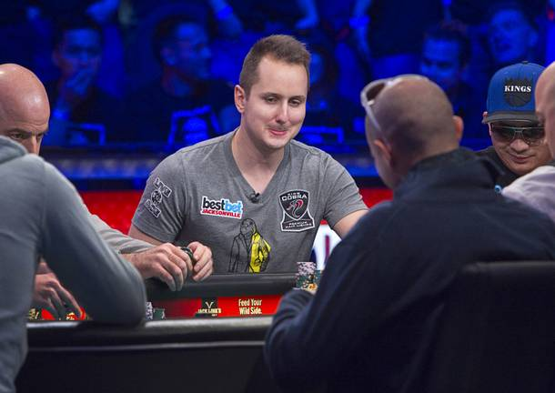 Marc-Etienne McLaughlin, 25, a poker player from Brossard, Quebec, Canada, competes during the final table of the World Series of Poker $10,000 buy-in no-limit Texas Hold 'Em tournament at the Rio Monday, Nov. 4, 2013. The 2013