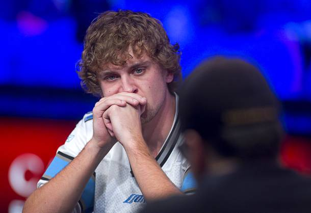 Ryan Riess, 23, a poker professional from East Lansing, Michigan who now resides in Las Vegas, competes across from Jay Farber during the final table of the World Series of Poker $10,000 buy-in no-limit Texas Hold 'Em tournament at the Rio Monday, Nov. 4, 2013.