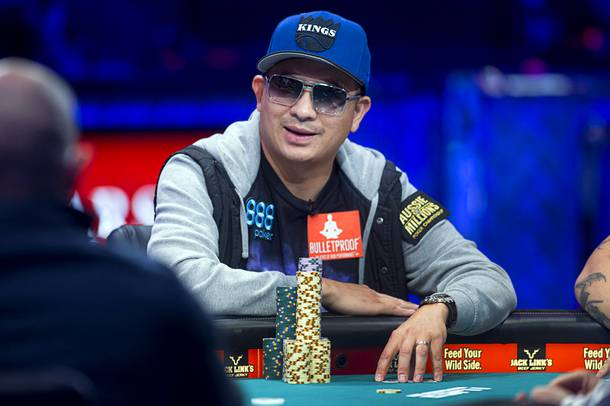 J.C. Tran, 36, a poker professional from Sacramento, Calif. competes during the final table of the World Series of Poker $10,000 buy-in no-limit Texas Hold 'Em tournament at the Rio Monday, Nov. 4, 2013.
