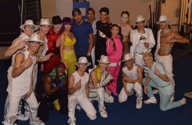 "Rapper J Cole with cast members of Cirque du Soleil's ""Michael Jackson One"" at Mandalay Bay."