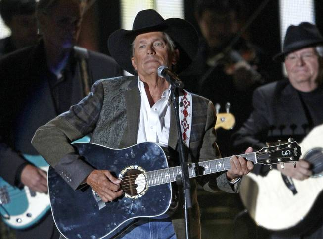 George Strait performs at the 47th annual CMA Awards at Bridgestone Arena on Wednesday, Nov. 6, 2013, in Nashville, Tenn.