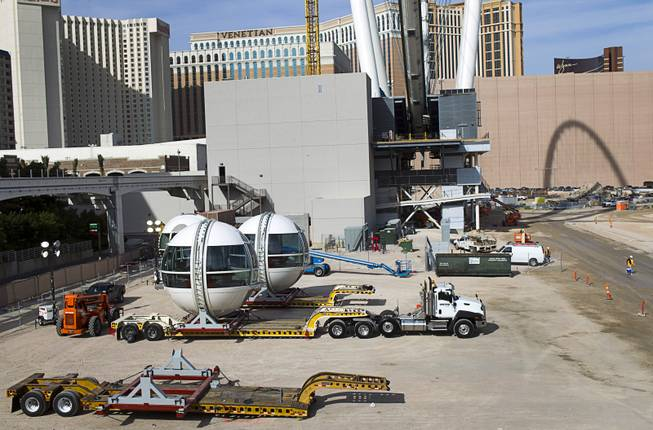 Cabins (L) are shown next to the 550-foot tall High Roller, the world's tallest observation wheel, under construction near the Las Vegas Strip and Flamingo Road Thursday, Nov. 7, 2013. The wheel is the centerpiece of the Linq project, a $550 million outdoor retail, dining and entertainment district being developed by Caesars Entertainment Corp. The High Roller will feature 28 cabins that will each hold 40 passengers.