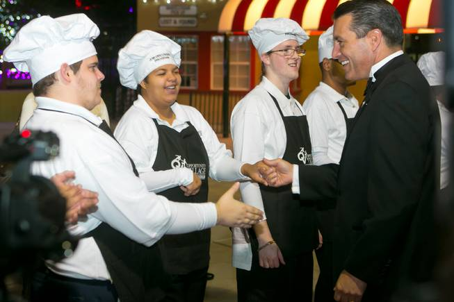 Gov. Brian Sandoval is greeted by students of Opportunity Village's Job Discovery Program during their 2013 Camelot Gala on Thursday, Nov. 7, 2013.