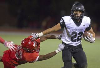 Arbor View's Salah Boyce (23) dives for a tackle attempt on Palo Verde's Calvin Beaulieu (22) but is late. Palo Verde beat Arbor View 21-7 in their high school football match up Friday, Nov. 8, 2013.