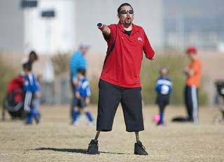 Youth soccer coach Eddie Garcia coaches his team from the sidelines during a game at Reunion Trails Park in Henderson on Saturday morning.