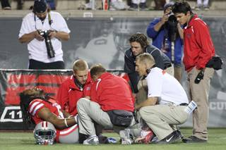 UNLV defensive back Frank Crawford winces in pain after injuring his knee on a play agasint Utah State during their game Saturday, Nov. 9, 2013 at Sam Boyd Stadium.