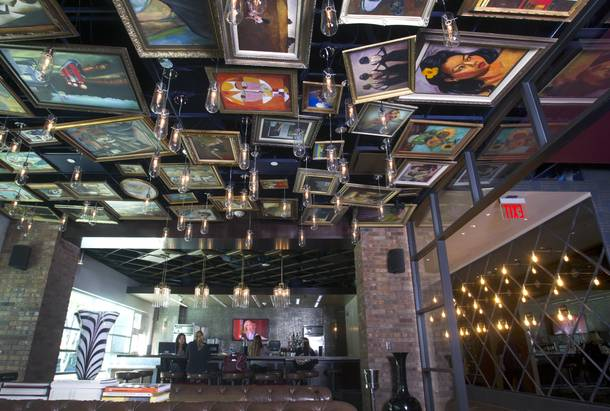 Replicas of famous paintings cover the ceiling of the Art Bar in the Downtown Grand Monday, Nov. 11, 2013.