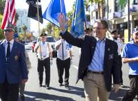 Congressman Joe Heck (R-NV) waves during the annual Veterans Day parade in downtown Las Vegas Monday, Nov. 11, 2013.