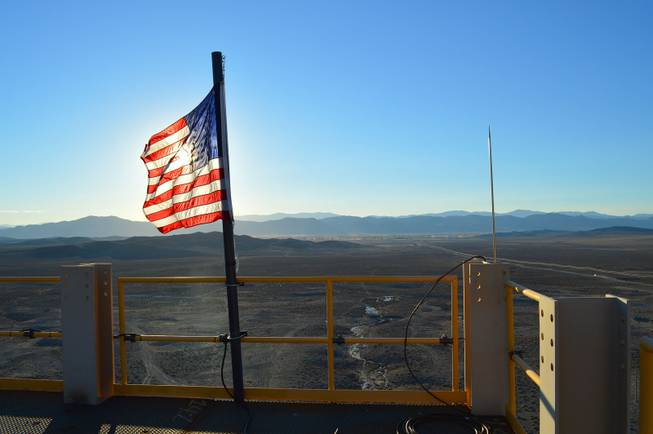 An American flag at the top of the headframe of the Nevada Copper mine outside of Yerington is shown on Oct. 23, 2013.