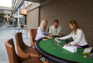 Angela And Tom Salestrom of Sioux Falls, S.D. are the first to try out the outdoor blackjack tables on Third Street following an official opening ceremony for the Downtown Grand in downtown Las Vegas Tuesday, Nov. 12, 2013.