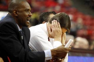 UNLV coach Dave Rice buries his head in his hands as UC Santa Barbara pulls away for a 86-65 upset Tuesday, Nov. 12, 2013 at the Thomas & Mack Center.