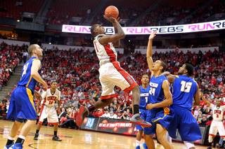 UNLV forward Roscoe Smith takes a shot over UC Santa Barbara guard Michael Bryson during their game Tuesday, Nov. 12, 2013 at the Thomas & Mack Center.  UC Santa Barbara won the game 86-65.