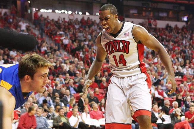 UNLV forward Jamal Aytes yells after a Khem Birch dunk against UC Santa Barbara during their game Tuesday, Nov. 12, 2013 at the Thomas & Mack Center.  UC Santa Barbara won the game 86-65.