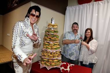 Elvis Presley minister Brendan Paul officiates the wedding of Bryan Porter and Darlene Hielscher, the first couple to marry in Las Vegas on Tuesday, Nov. 11, 2013 — or 11/12/13 — at Smashburger.