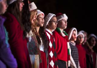 A choir comprised of Las Vegas school students performs holiday songs to open the 20th anniversary of Ethel M's Cactus Lighting event on Tuesday, Nov. 12, 2013.