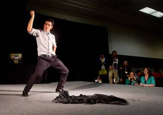Student Giovanny Vasquez of Western High School dances on stage during a lunch break at the annual Las Vegas Sun Youth Forum in the Las Vegas Convention Center Wednesday, Nov. 13, 2013.