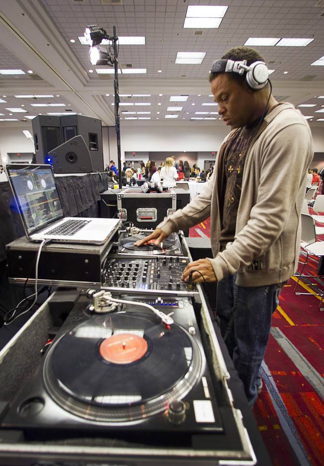 Darrell Sherrod, also know as DJ Twin, provides musical entertainment during a lunch break at the annual Las Vegas Sun Youth Forum in the Las Vegas Convention Center Wednesday, Nov. 13, 2013.